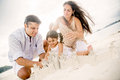 Family building sand castles Royalty Free Stock Photo