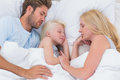 Beautiful family sleeping together in bed Stock Photos