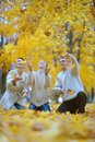 Beautiful family throw autumn leaves portrait of a happy Royalty Free Stock Photos