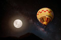 Beautiful fantasy of hot air balloon and full moon with milky way star in night skies background. Royalty Free Stock Photo