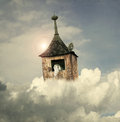 Beautiful fantasy tower house as an noah s ark that flying in the clouds with a white horse inside and a owl on the roof Royalty Free Stock Photos