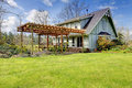 Beautiful farmhouse with attached pergola. Early spring Royalty Free Stock Photo