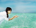 Beautiful fashion asian girl play water in summer Stock Images
