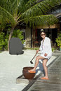 Beautiful fashion asian girl wash sand away foot Royalty Free Stock Photography