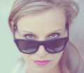 Beautiful fashion girl portrait with sunglasses of woman in retro tones Stock Image