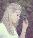 Beautiful fashion girl portrait with sunglasses of woman in retro tones Stock Photo