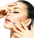 Beautiful fashion girl s face make up and manicure Stock Image
