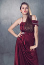 Beautiful fashion model elegant dress made red silk elegance fashion portrait Stock Image