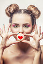 Beautiful fashion model girl with sweet cookies with hearts on a Royalty Free Stock Photo