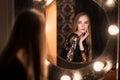 Beautiful fashion model woman posing near the mirror Royalty Free Stock Photo