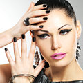 Beautiful fashion sexy woman with black nails at pretty face pretty girl model stylish bijouterie of silver color Royalty Free Stock Image