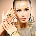 Beautiful fashion woman with black makeup and golden manicure portrait of the Royalty Free Stock Photography