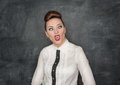 Beautiful fashion woman with crazy grimace on the blackboard background Stock Photo