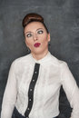 Beautiful fashion woman with crazy grimace on the blackboard background Stock Image