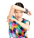 Beautiful fashion woman dressed in colorful checkered dress and Royalty Free Stock Photo