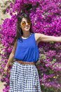 Beautiful fashion woman  in front of a pink bougainvilleas flowers Royalty Free Stock Photo