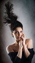 Beautiful fashion woman model with chignon on her head posing in studio Stock Image