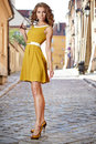 Beautiful fashion woman outdoor on the street of the old town Royalty Free Stock Images