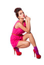 Beautiful fashion woman in pink attractive dress showing legs and funky hairstyle Stock Photography