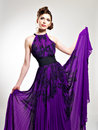 Beautiful fashion woman in purple long dress Royalty Free Stock Photo