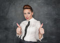 Beautiful fashion woman showing thumbs up sign on the blackboard background Stock Photo