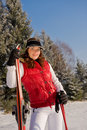 Beautiful fashion woman with skis in winter Royalty Free Stock Image