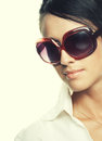 Beautiful fashion woman wearing sunglasses over a white background Stock Image