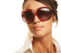 Beautiful fashion woman wearing sunglasses over a white background Stock Photography