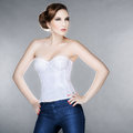 Beautiful fashionable woman corset gray background Royalty Free Stock Photo