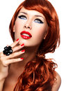 Beautiful fashionable woman with red nails and red hairs portrait of a fashion model bright eye makeup isolated on white Stock Photos