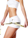 Beautiful feamle body with measuring tape healthy lifestyle cocnept Stock Images