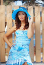 Beautiful female in blue lady's hat Stock Image