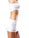 Beautiful female body in white sport clothes Stock Image