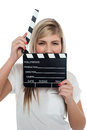Beautiful female with clapperboard. It's showtime. Royalty Free Stock Image