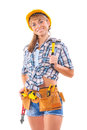Beautiful female construction worker holding claw hammer and oth other tools looking at camera smiling Stock Image