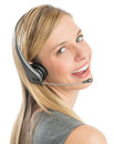 Beautiful female customer service representative wearing headset close up portrait of against white background Stock Photography