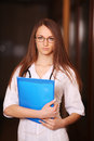 Beautiful female doctor in hospital corridor Royalty Free Stock Images