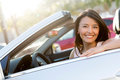 Beautiful female driver in a convertible car smiling Royalty Free Stock Photos