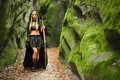 Beautiful female elf archer in the forest hunting with a bow