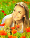 Beautiful female enjoying on the flower field Royalty Free Stock Image