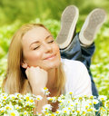 Beautiful female enjoying flower filed Stock Photography