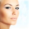 Beautiful Female Face Over Blu...