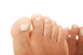 Beautiful female feet close up on toes isolated white Stock Photo