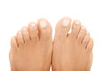 Beautiful female feet close up on toes isolated white Stock Images