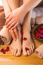 Beautiful female feet and hands, spa salon, pedicure and manicure procedure Royalty Free Stock Photo