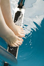 Beautiful female feet on the steps of the pool Royalty Free Stock Photo