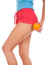 Beautiful female figure with an orange. Royalty Free Stock Photo