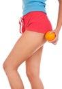 Beautiful female figure with an orange. Royalty Free Stock Photo