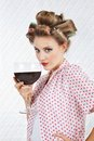 Beautiful female with giant wineglass portrait of young hair curlers holding glass of wine Royalty Free Stock Image