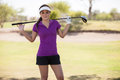 Beautiful female golf player portrait of a cute young woman holding a club Stock Image